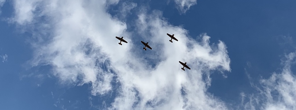 Royal Canadian Air Force planes performing a fly-by